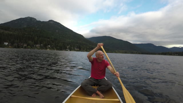 Young man enjoying an early morning paddle