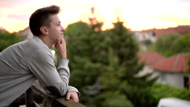 young man enjoying at sunset. - looking around stock videos and b-roll footage