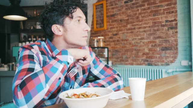 young man enjoying his salad. - curly stock videos & royalty-free footage