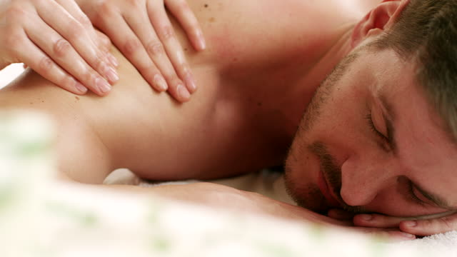young man enjoying massage - massage stock videos & royalty-free footage