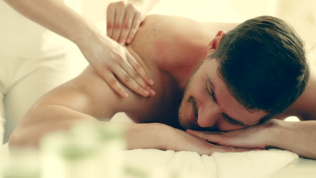young man enjoying massage - masseur stock videos & royalty-free footage