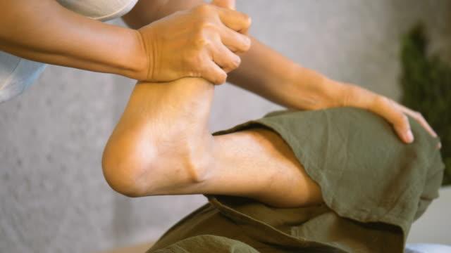 young man enjoying thai massage - masseur stock videos & royalty-free footage
