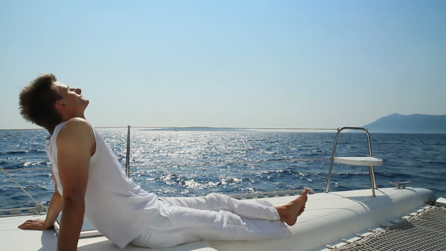 hd: young man enjoying the sailing - handsome people stock videos & royalty-free footage