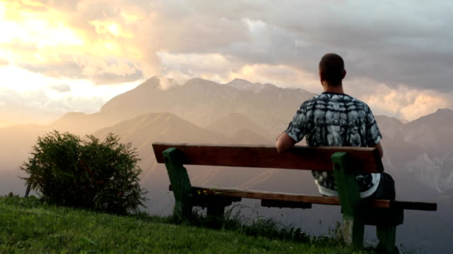 young man enjoying the view - bench stock videos and b-roll footage