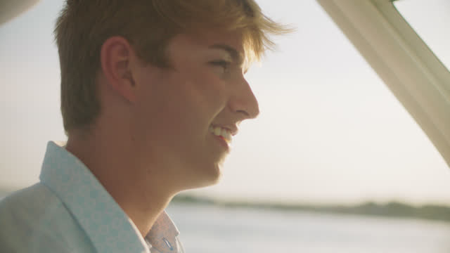 slo mo cu young man enjoys the nautical view from a boat - smart casual stock videos & royalty-free footage