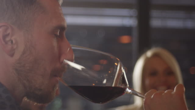 Young Man Enjoys With Glass of Red Wine 4K slow motion