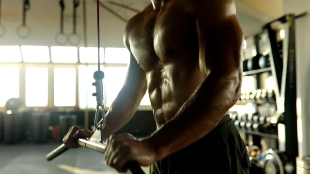 young man exercise on exercise-machine in gym - abdominal muscle stock videos & royalty-free footage