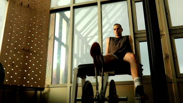 young man exercise on exercise-machine - exercise machine stock videos & royalty-free footage