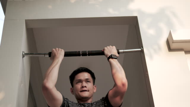 young man exercising - pull ups stock videos & royalty-free footage