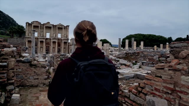 Young man explores ruins of ancient Greek civilization