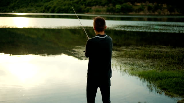 young man fishing - fishing rod stock videos and b-roll footage