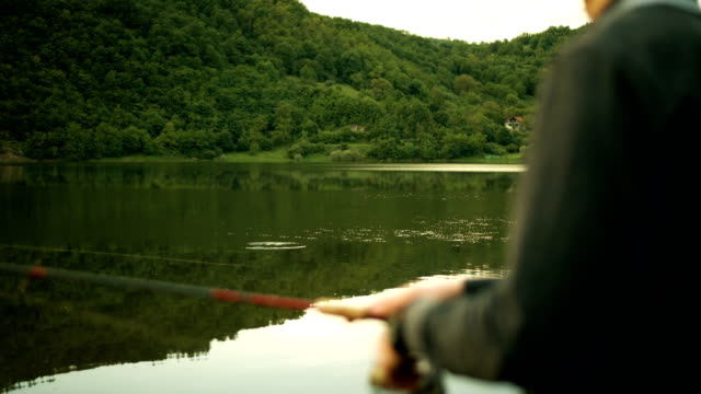 young man fishing - fishing reel stock videos and b-roll footage