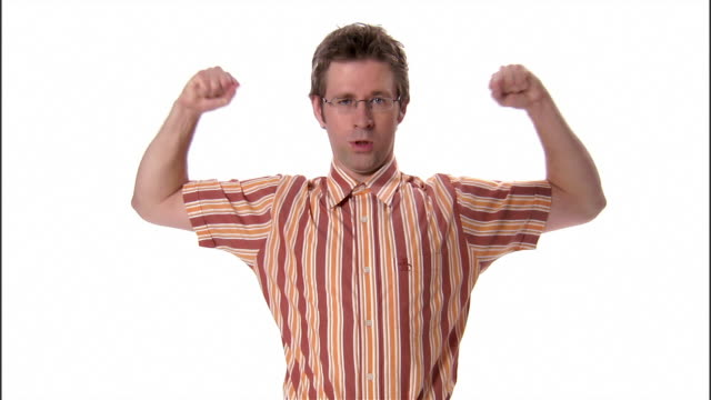 ms, young man flexing muscles in studio - showing off stock videos & royalty-free footage