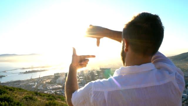 Young man framing nature