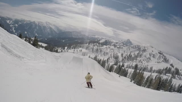 a young man freestyle skier crashes into snow while skiing off a jump in a terrain park.  - slow motion - ski stock videos & royalty-free footage