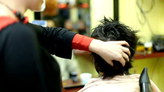 young man getting his hair dryed - small stock videos and b-roll footage
