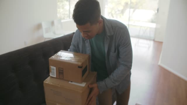 ws young man getting packages at home - front door stock videos & royalty-free footage