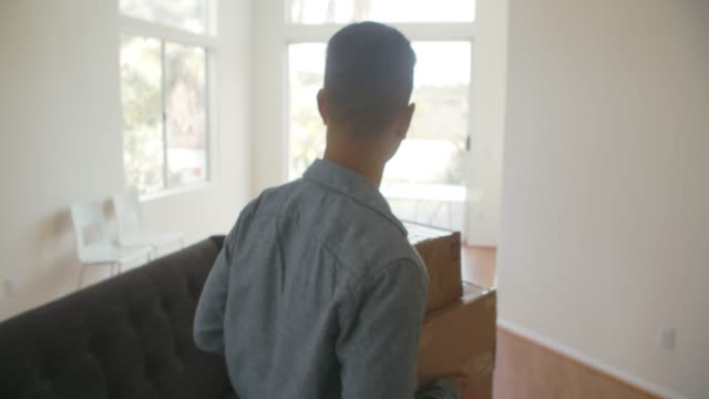 ms young man getting packages delivered at home - lieferant stock-videos und b-roll-filmmaterial