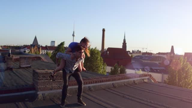 Young man gives girlfriend a piggyback