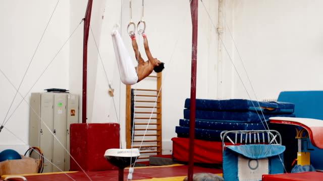Young man gymnastics on horizontal bar