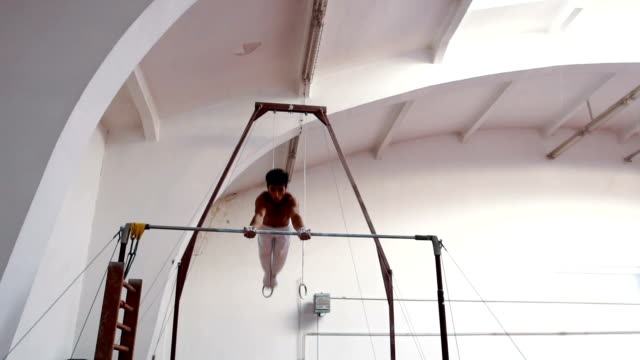 young man gymnastics - horizontal bar stock videos and b-roll footage