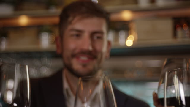 young man have a toast with friends slow motion 4k - drinking glass stock videos & royalty-free footage