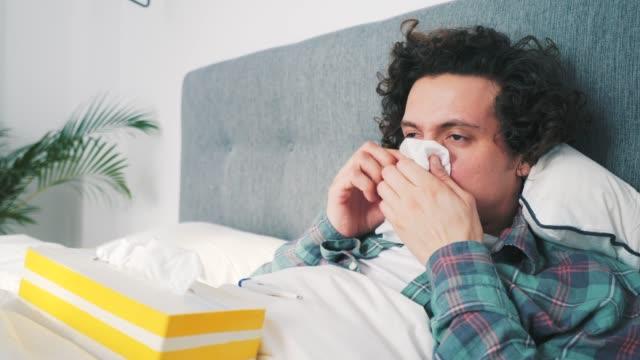 vídeos de stock e filmes b-roll de young man having flu. - cold temperature