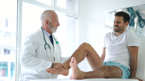 young man having his knee examined. - injured stock videos & royalty-free footage