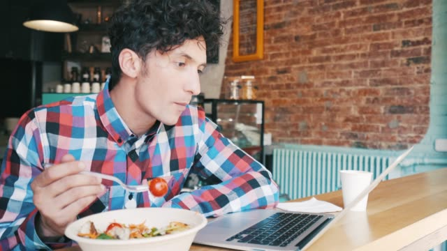 young man having lunch. - salad stock videos & royalty-free footage