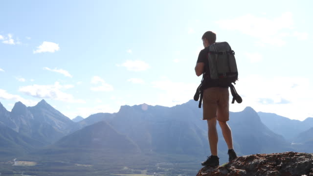 young man hikes along rock ridge crest - moving up stock videos & royalty-free footage