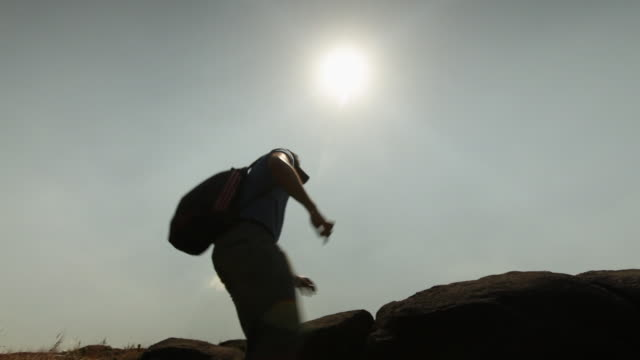 young man hiking on mountains  - low angle view stock videos & royalty-free footage