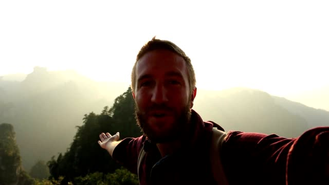 young man hiking takes selfie portrait - sandstone stock videos and b-roll footage