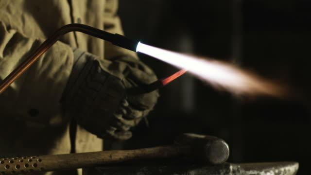 cu tu young man holding welding torch / orem, utah, usa. - orem utah stock videos & royalty-free footage