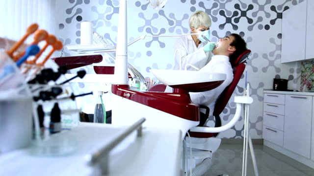 young man in dentist office - dental equipment stock videos and b-roll footage