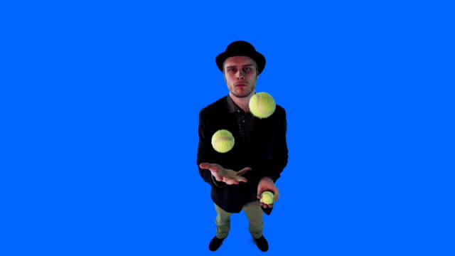 young man in hat juggling balls - juggler stock videos and b-roll footage