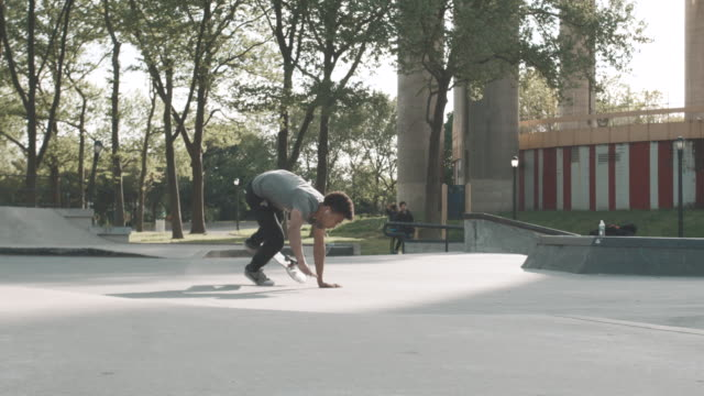 A young man in his twenties crashes his skateboard in Queens - NYC - 4k - slow motion