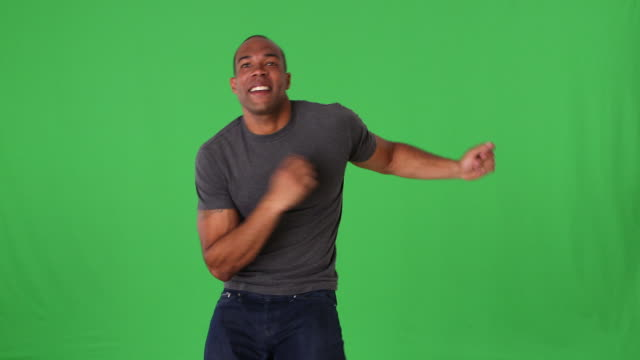 young man in jeans and t-shirt dancing - haltung stock-videos und b-roll-filmmaterial