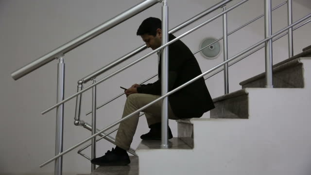 young man in office space - staircase stock videos & royalty-free footage