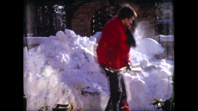 1977 young man in red jacket digs out snow with shovel - spade stock videos & royalty-free footage