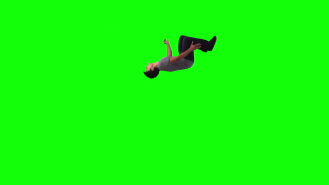young man in slow motion performing a backflip - acrobatic activity stock videos & royalty-free footage