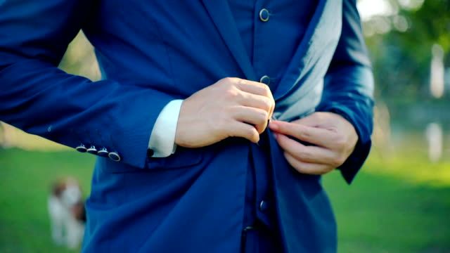 young man in suit with buttoning his jacket. - suit jacket stock videos & royalty-free footage