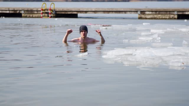 young man in the ice hole - hole stock videos and b-roll footage