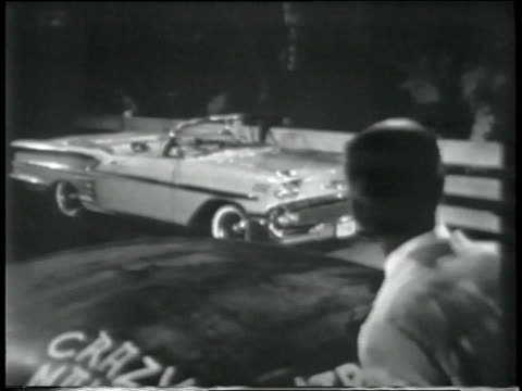 1958 MONTAGE Young man in white tuxedo saying goodbye to family as he leaves for the prom, father relenting and lets him take his Chevrolet Impala convertible