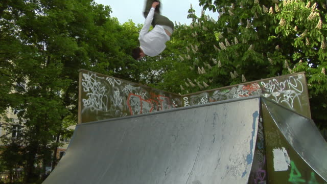 ws young man inline skating on pipe, berlin, germany - half pipe stock videos & royalty-free footage