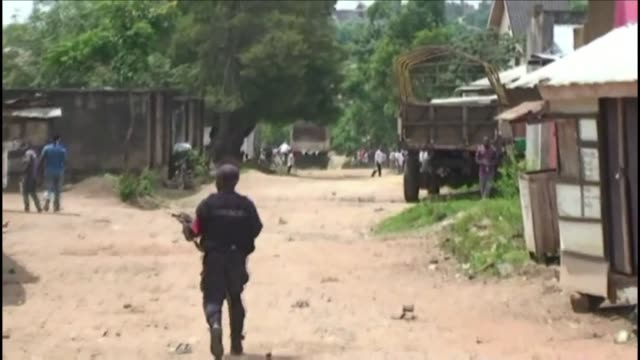 young man is shot dead when security forces open fire at a crowd protesting the governments alleged failure to protect civilians after a gruesome... - democratic republic of the congo stock videos & royalty-free footage