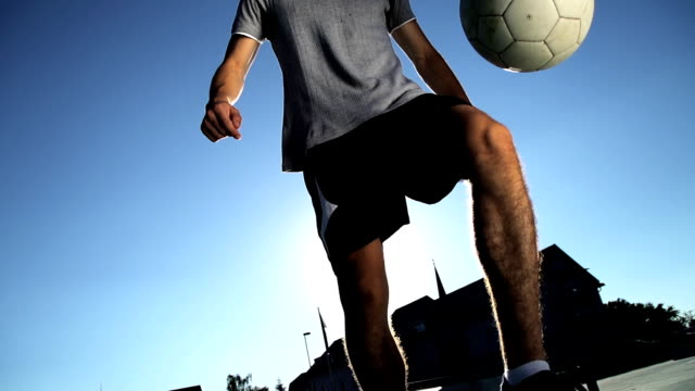 HD SUPER SLOW-MO: Young Man Juggling A Ball