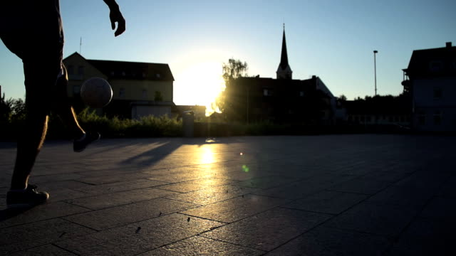 hd super slow-mo: young man juggling a ball - juggling stock videos & royalty-free footage