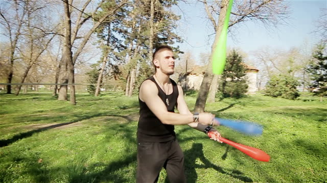 young man juggling,camera stabilization shoot - juggling stock videos & royalty-free footage
