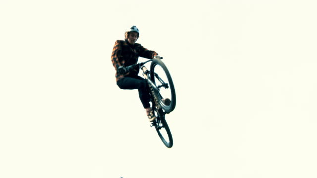 ms young man jumping bmx bicycle above ramp - challenge stock videos & royalty-free footage