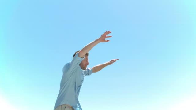 young man jumping in slow motion - nur junge männer stock-videos und b-roll-filmmaterial